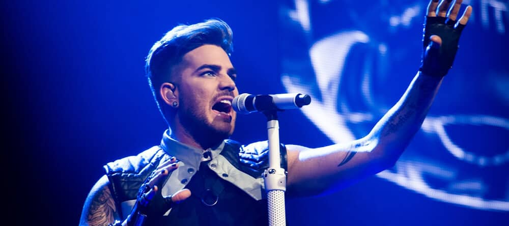 Adam Lambert singing in live performance.