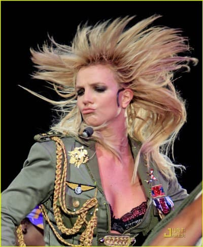 The famous American singer Britney Spears crazy performing on the stage.