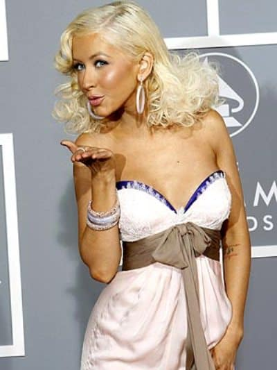 Christina Aguilera posing on Annual Grammy Awards's red carpet.