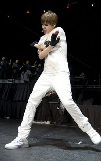 Justin Bieber singing and dancing at the 2010 B96 Jingle Bash Show at the Allstate Arena.