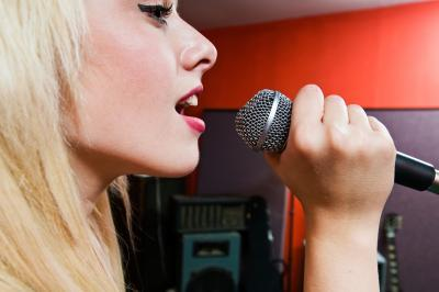Girl vocal exercise training in the karaoke room to improve her singing voice.