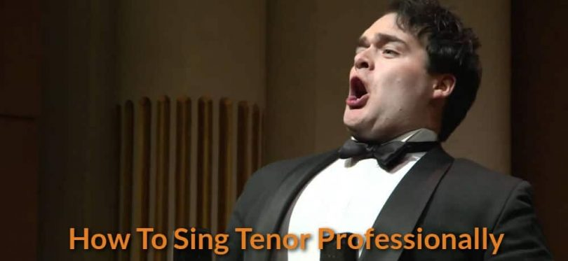 Tenor is singing classical song on stage.
