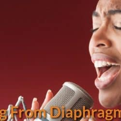 A singer singing through her stomach