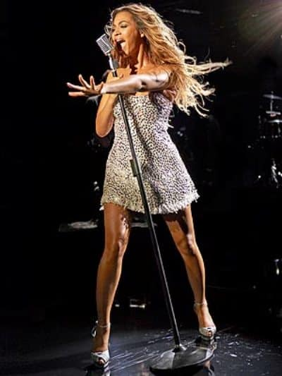 The sexy American pop singer Beyonce performs on the stage successfully.
