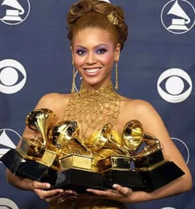 Beyonce won 5 awards and poses during the 2004 Grammy Awards.