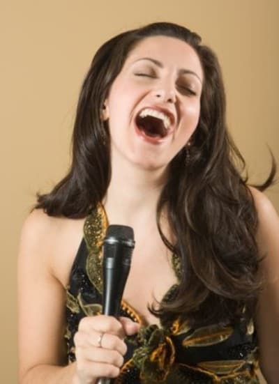 A woman doing vocal exercises to improve her vocal range and expanding her vocal too.