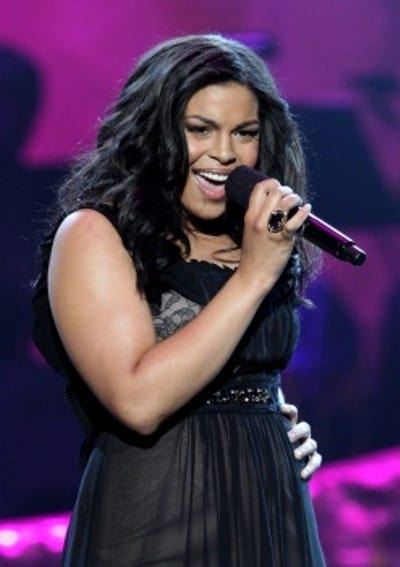 Wearing black dress Jordan Sparks performs on the stage during the 39th MAACP.