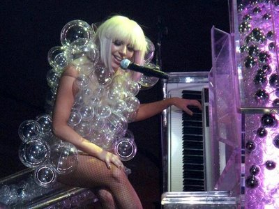 Wearing bubble coat American pop singer Lady Gaga performs on the stage.