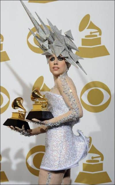 Lady Gaga poses with her 2 awards in the press room during the 2010 Grammy Awards.