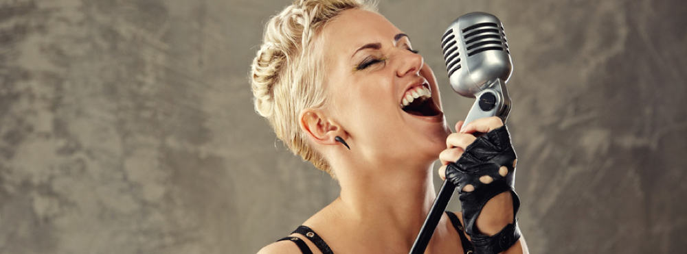 Singer scaling her vocal from low to high notes.