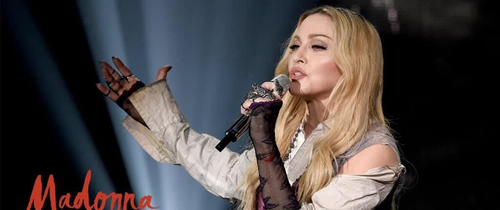 Madonna singing live in concert.