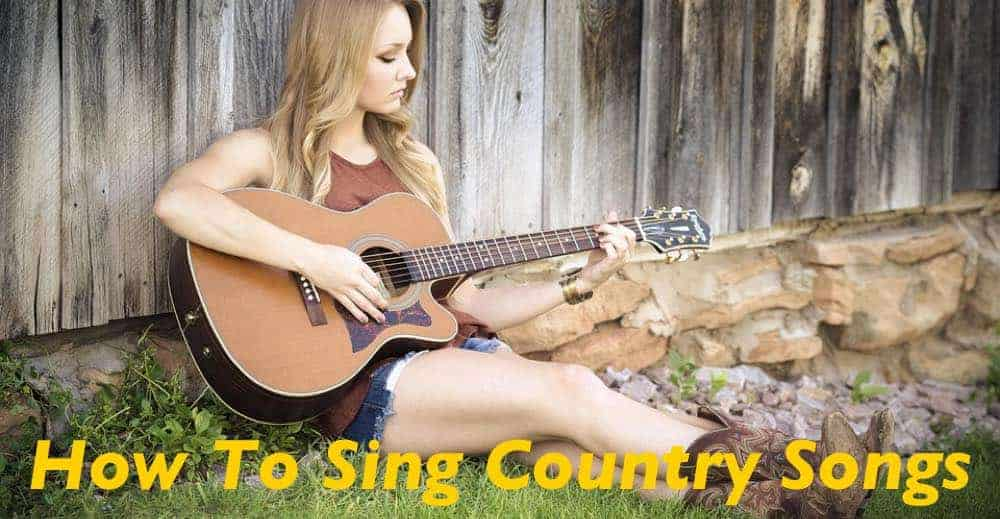 Country singer playing guitar in the farm.