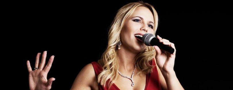 A singer is singing in alto range.
