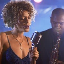 Female singer is singing jazz song.