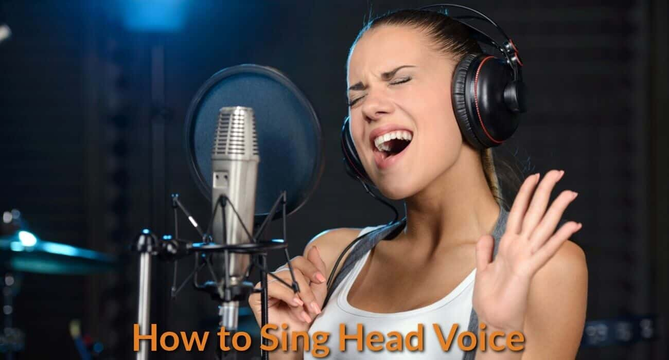 A singer is singing in high notes with her head voice in the the studio.