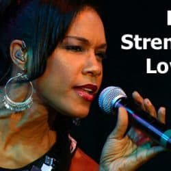 A female singer is singing lower notes.