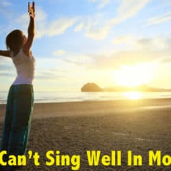 Woman warm up her voice on the beach in the morning.