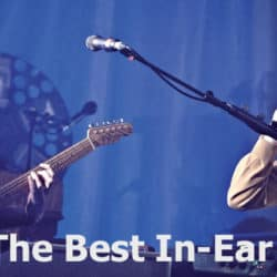 A singer and guitar player are fitting their in-ear monitors.