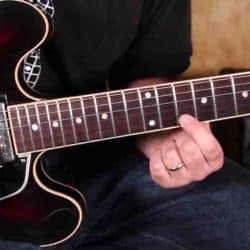 Playing Blues electric guitar.