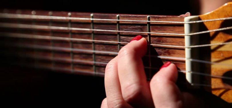 Practising guitar chords.