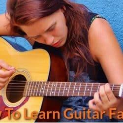 Practising guitar.