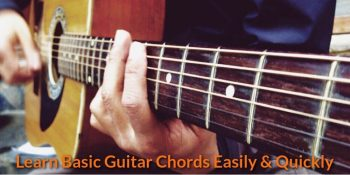 A singer is learning the guitar chord.