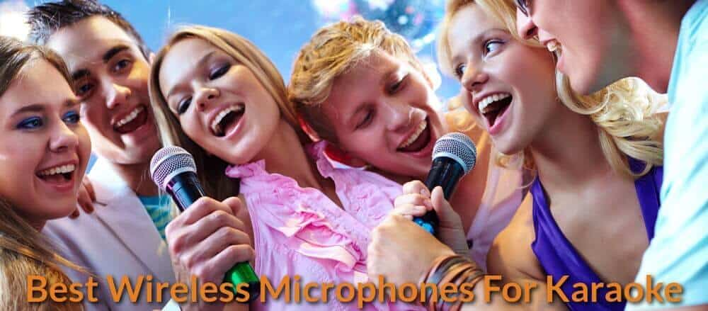 Having fun singing karaoke with friends using wireless mics.