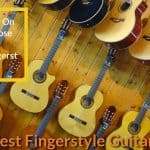 Different brands fingerstyle guitars hanged on the wall.