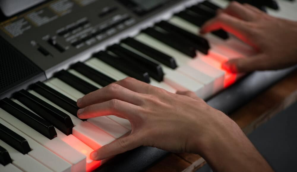 Beginner learning piano with the light-up keys keyboard.