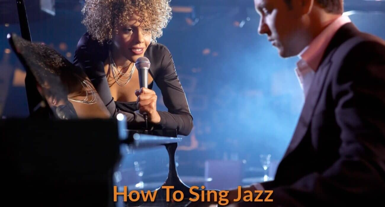A jazz singer is singing with a singing with piano accompaniment.