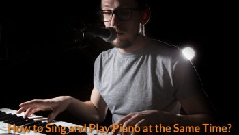 A singer is singing and playing piano on stage.