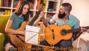 A guitar teacher is teaching a student.