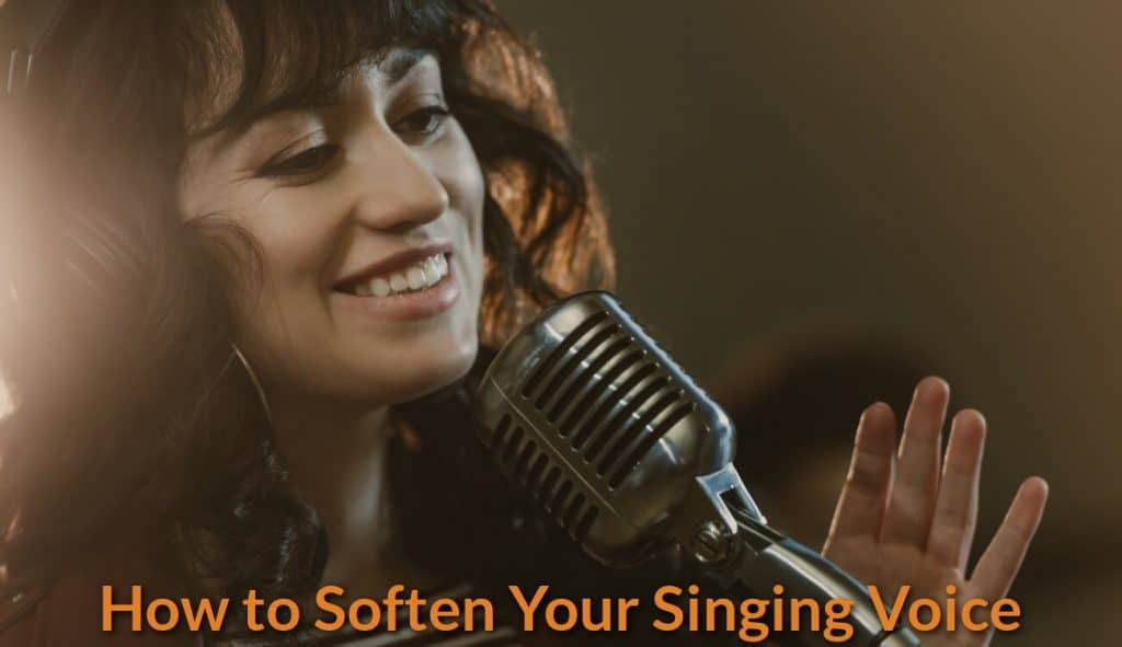 A female singing with smile.