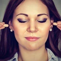 Wearing noise reducing earplugs.