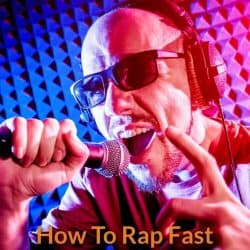 Singer is singing rap song in the fast pace.