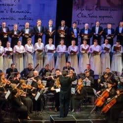 Chorus group singing in unison in concert.