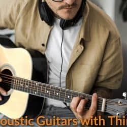 A guitarist practice with a thinner neck acoustic guitar.