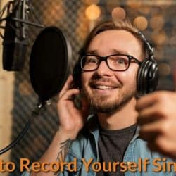Singer recording his own voice in DIY way.