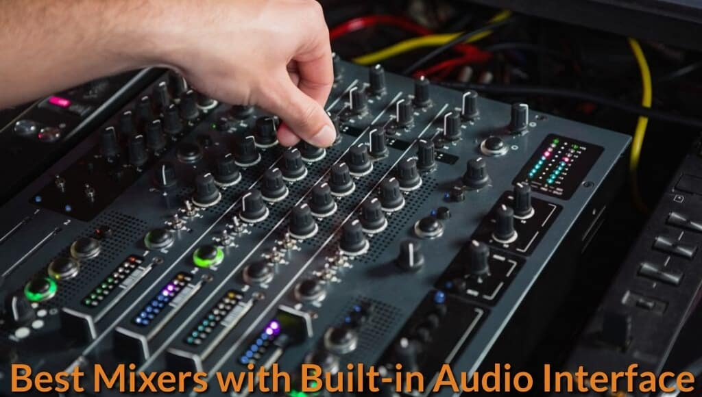 Music producer adjusting the knobs of audio interface mixer.