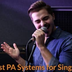 A singer is using PA system speaker to amplify his singing voice.