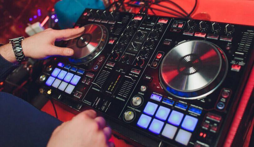 DJ making music on a DJ controller.