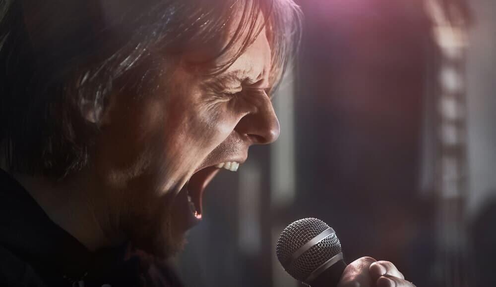 Singer singing metal song loudly.