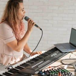 Singing karaoke on the laptop.