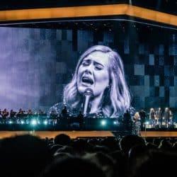 Adele singing on stage.