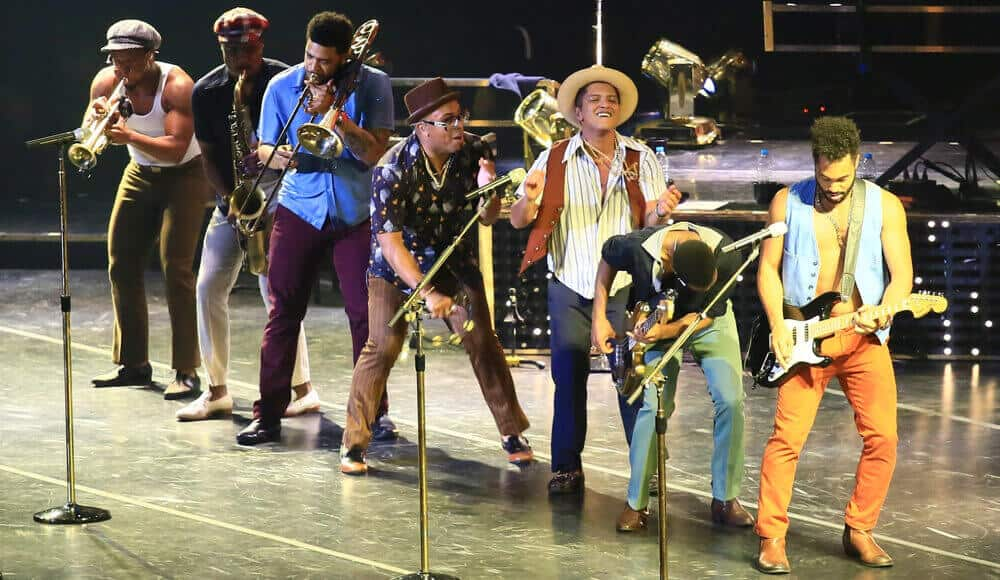 Bruno Mars singing in the concert.