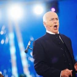 Top baritone singer performing live.