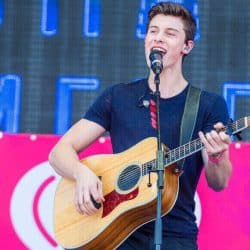 Shawn Mendes singing in the concert.