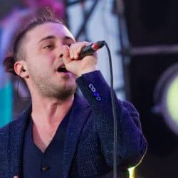 Singer wearing IEM earphone when singing on stage.