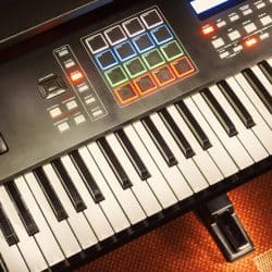 Musician use Midi keyboard to create beats tracks.