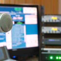 Condenser microphone recording setups in studio.